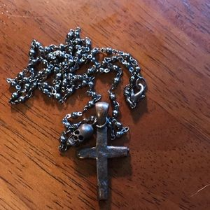 Cross and skull necklace.